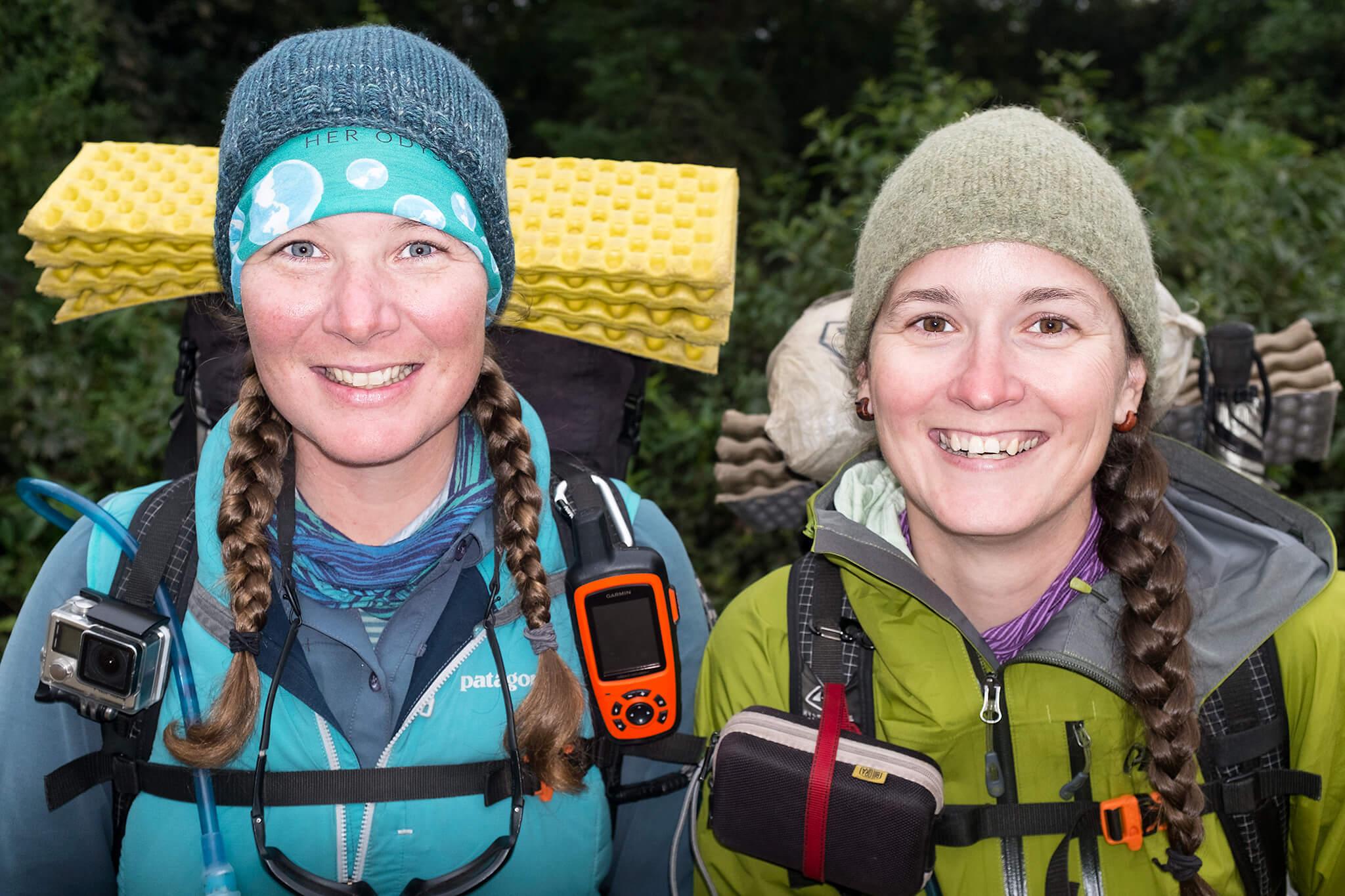 Two women in hiking gear smiling