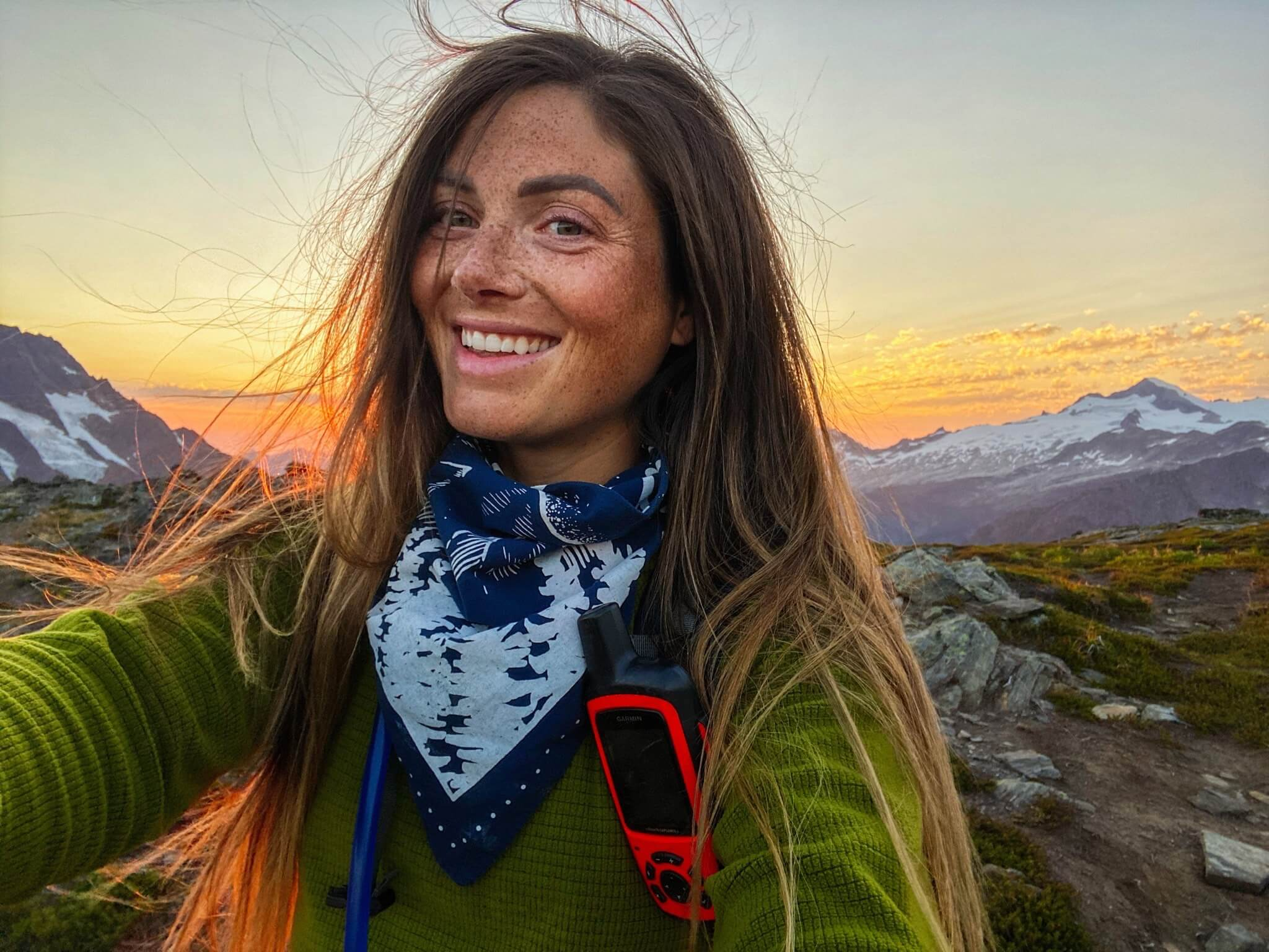 Woman smiling on mountain top