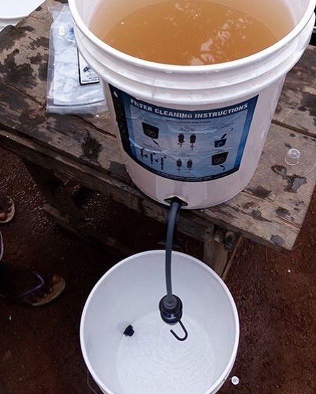A Sawyer Bucket Gravity Filtration System Cleans Visually Dirty and Undrinkable Water into Clear Clean Drinking Water