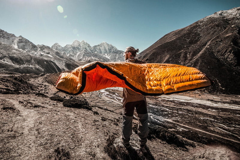 man-with-sleeping-blanket-or-quilt-in-the-mountains-2-2-800x800