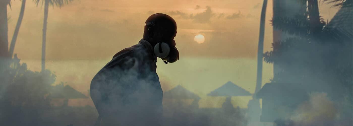 smarter travel zika man-spraying-zika-defogging-1400x500