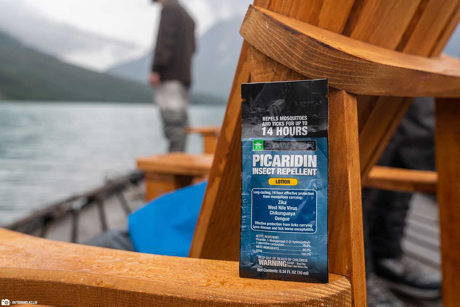 Sawyer Picaridin Insect Repellent Packet Sitting on a Chair on a Dock