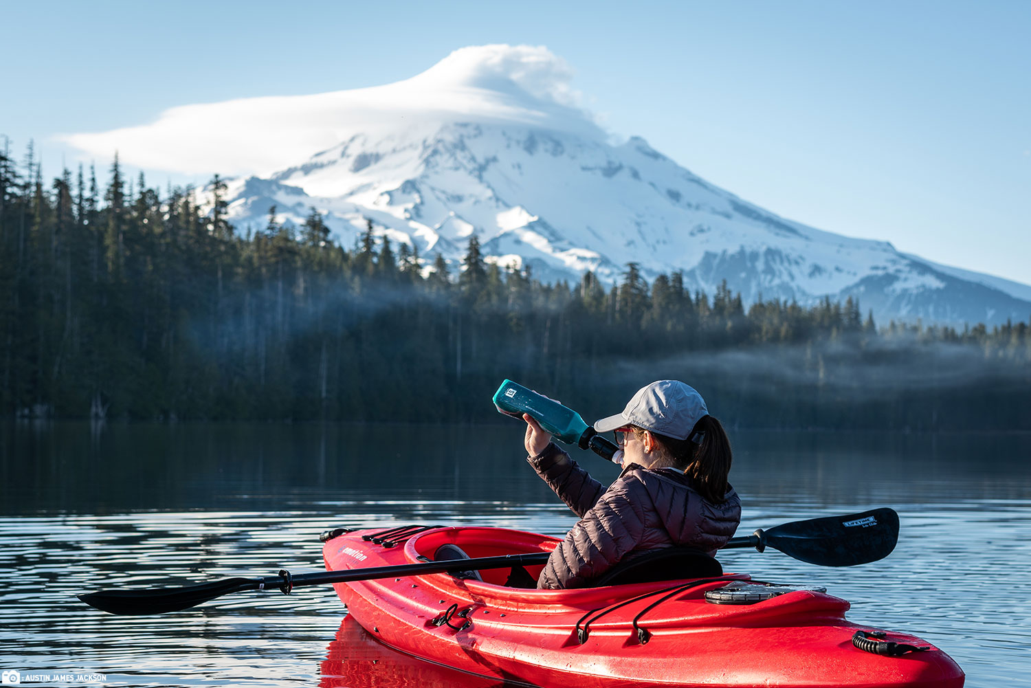 A Woman Drinks Water from her Sawyer Select S1 Filter While Kayaking