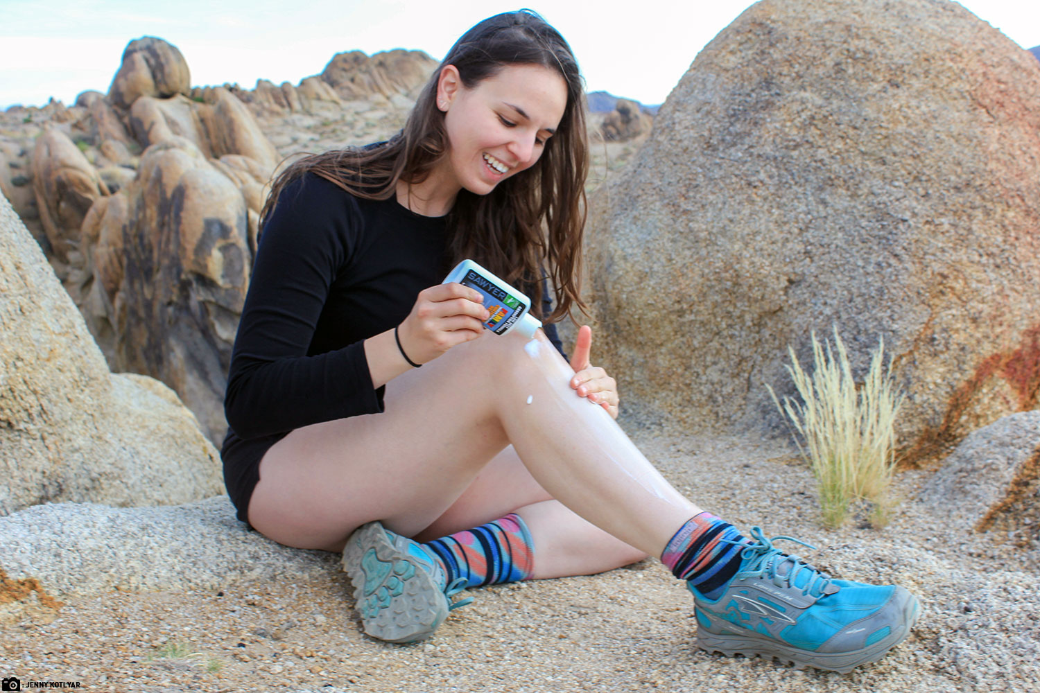 A Woman Applying Sawyer Controlled Release Topical Insect Repellent While out on an Adventure