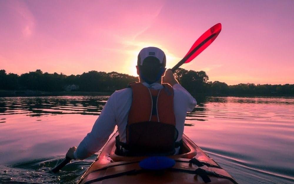 A-man-paddles-a-kayak.
