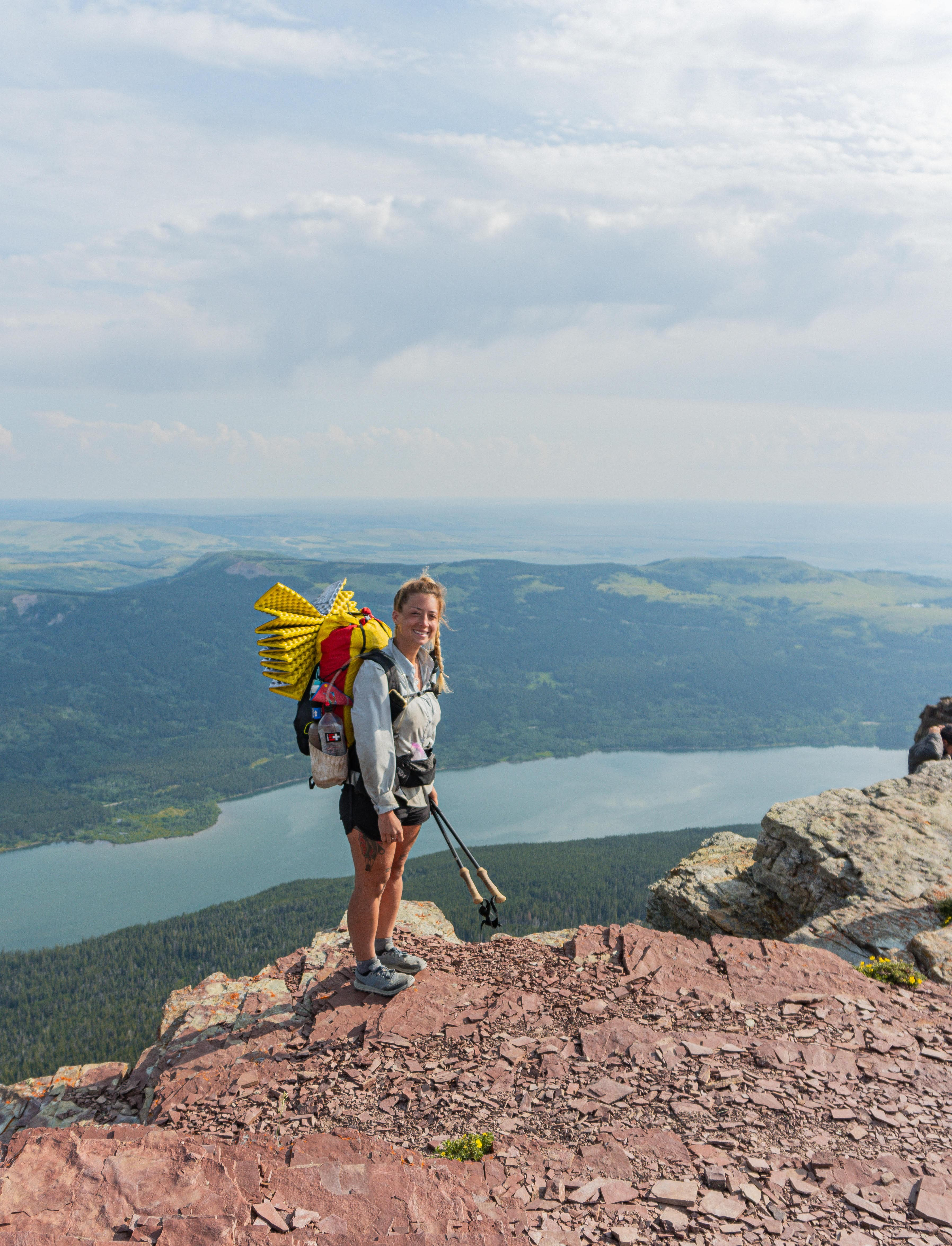 Woman takes in a view while backpacking